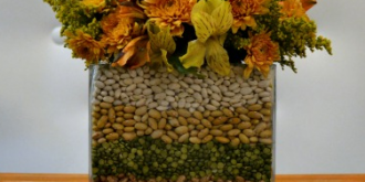 Make a simple fall flower arrangement by layering beans, lentils, peas and corn between two glass vases