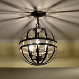 Transform an outdated chandelier into a modern orb pendant light with hanging flower baskets