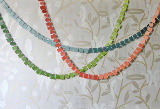 Garland made from rectangles cut from paint chips.  From My Hands Made It blog.