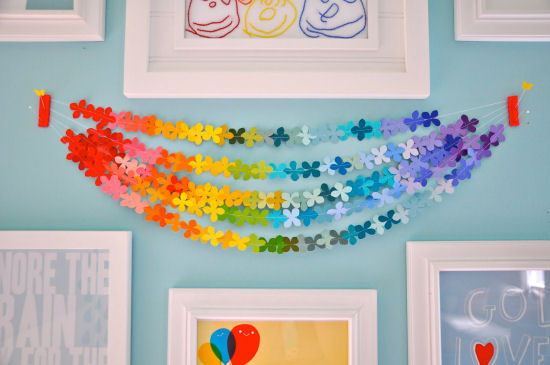 Paper punch flower rainbow colored garland created from paint chips.  From Little Bit Funky blog.