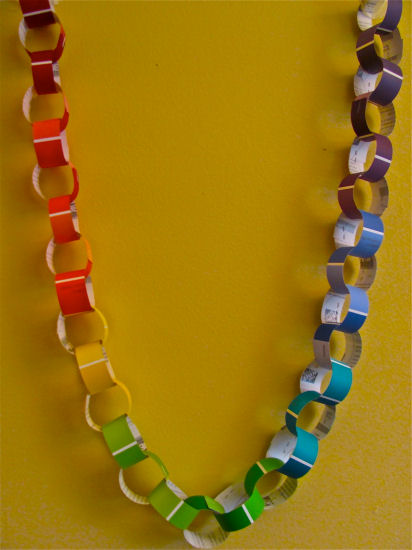 Colorful paper chain created with paint chip cards.  From The Chocolate Muffin Tree blog.