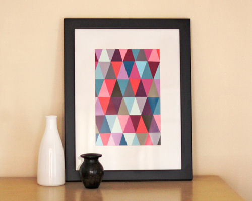 Artwork created with triangles cut from paint chips and adhered side-by-side, from How About Orange