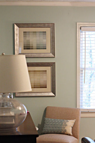 Create beautiful artwork by framing paint chip strips.  From Bower Power blog.