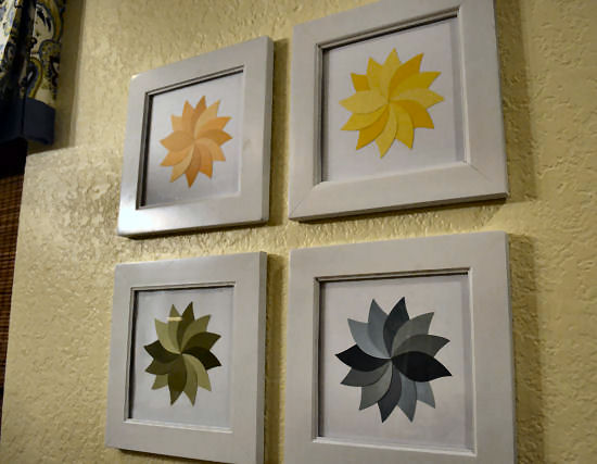 Create bold, graphic flower artwork by cutting petals from paint chips.  From Addicted 2 Decorating.