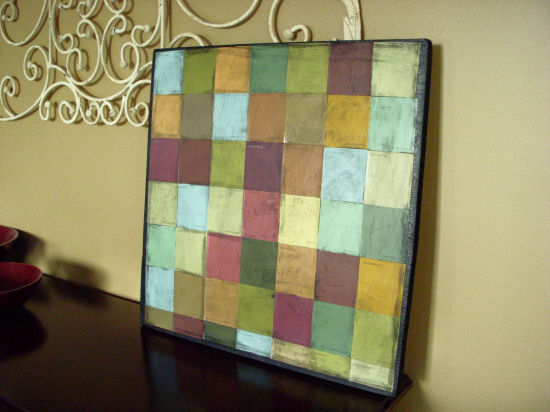 Antiqued mosaic wall hanging made from square paint chips