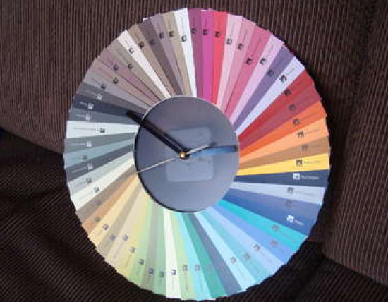 Colorful clock made from a fan deck of paint chip cards