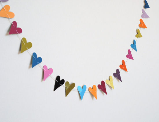 Paper punch heart garland created from paint chips.  From Grace and Light blog.
