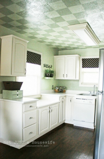 Kitchen ceiling with painted checked design dark green and light green squares alternating