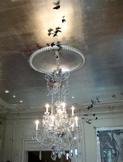 Dramatic ceiling with silver leaf and crystal chandelier