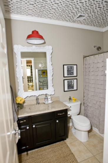 Neutral bathroom with stenciled trellis design on ceiling