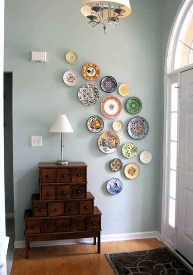 free form decorative plate wall in entryway
