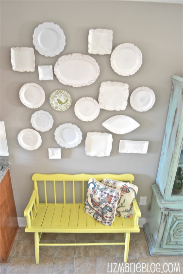 monochromatic decorative plate wall with white plates