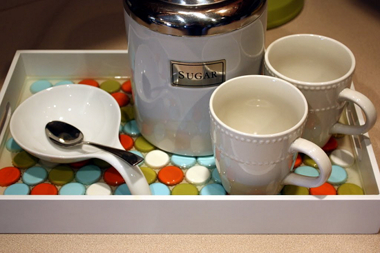 Serving tray tiled with bottle caps set in epoxy