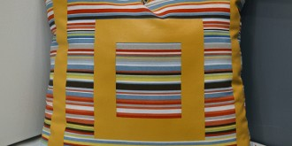 striped pillow with painted detail 1