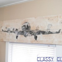 inspiration files--diy rustic wood valance with airplane transfer from classy clutter