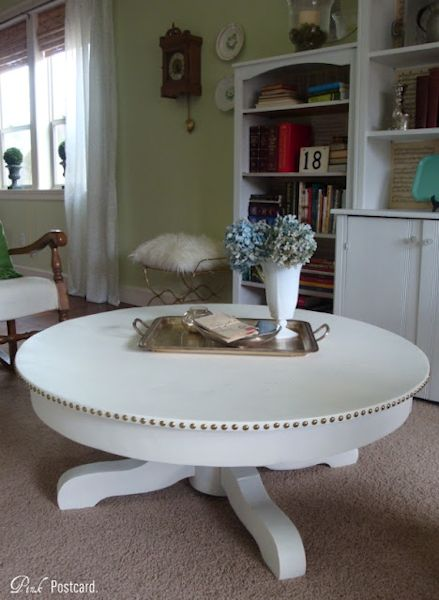 Coffee table makeover from Pink Postcard - after - painted white round coffee table with nail head trim accent