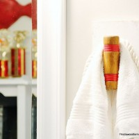 Turn unused croquet mallets into unique towel hooks for your bathroom, and easy DIY project.
