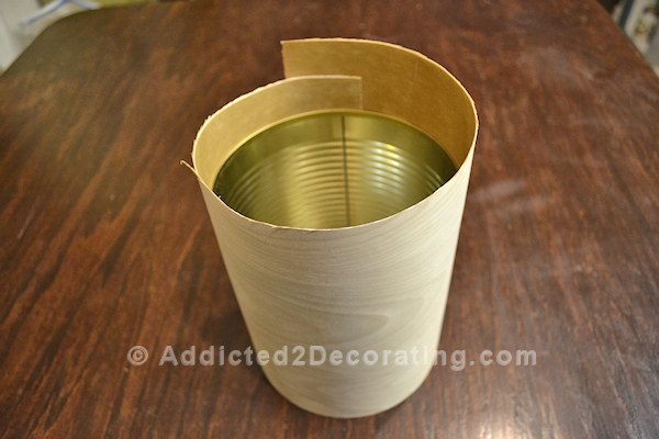 Wrap a coffee can in wood veneer to create a pretty vase