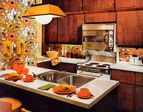 orange and brown 1960s kitchen with orange floral wallpaper