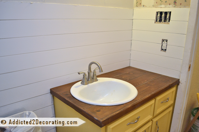 faux wood plank wall treatment in a bathroom
