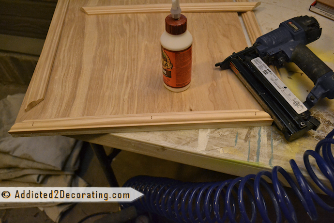 Add trim to cabinet doors