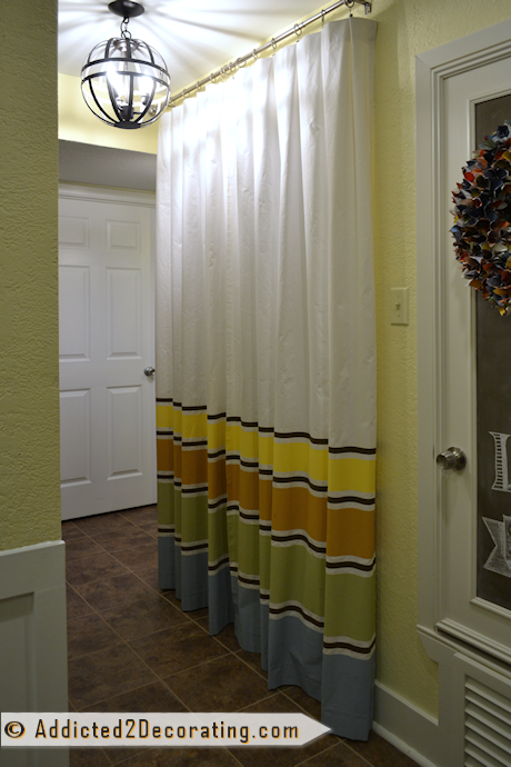 condo hallway makeover with curtains with painted stripes