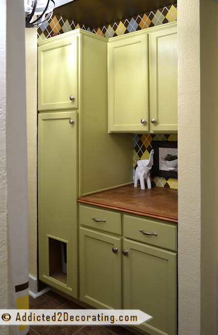 small condo coat closet turned into utility / laundry room with cabinets