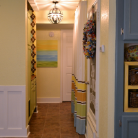 Small condo laundry room disguised as a hallway