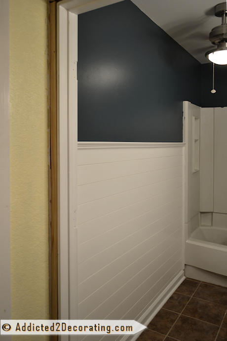 Bathroom makeover - faux wood plank wainscoting painted bright white with dark teal upper walls