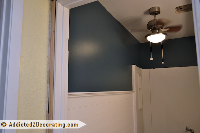 Dark teal wall color called Mystic Forest by Behr