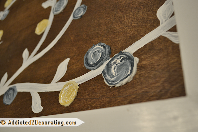 DIY artwork with dimesional flowers made from drywall mud