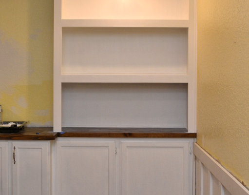 DIY built-in bookcase wall - one side painted with lighting installed