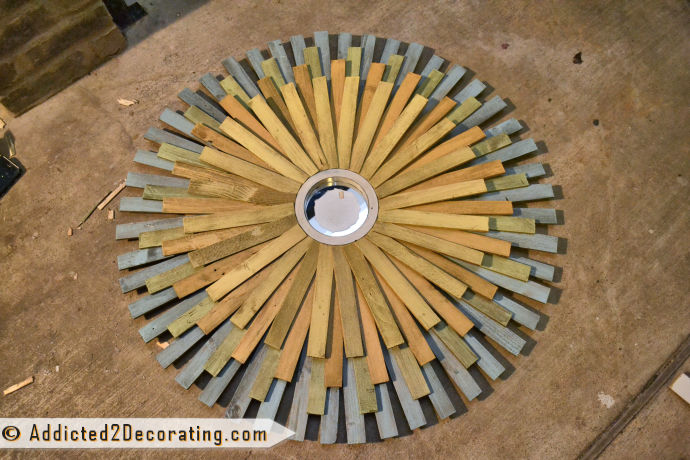 How to make a large multi-colored wood shim sunburst mirror - attach 24 of two more colors in staggered pattern