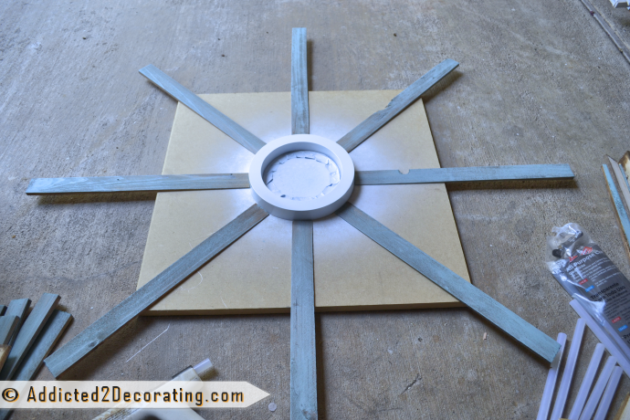 How to make a large multi-colored wood shim sunburst mirror - attach the first row of wood shims