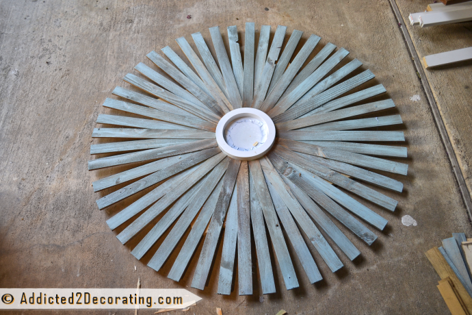 How to make a large multi-colored wood shim sunburst mirror - first row with 48 wood shims