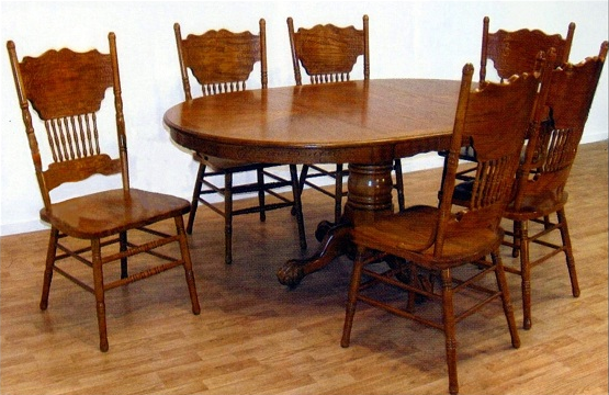 Claw foot pedestal dining table with press back dining chairs