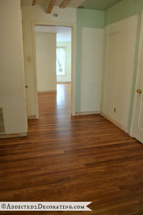 Hallway with 65-year-old hardwood floors refinished, and closet added in the 70s removed