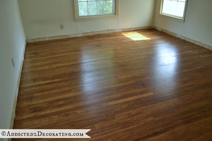 Master bedroom after old carpet was removed and the original 65-year-old hardwood floors refinished