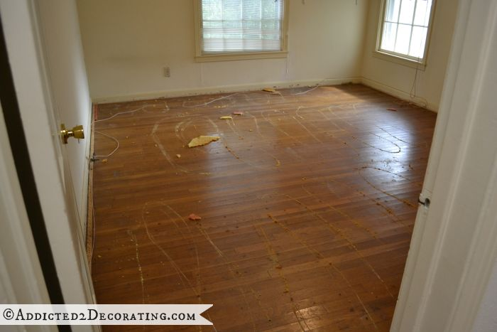 Master bedroom original hardwood floors after 30-year-old carpet was removed