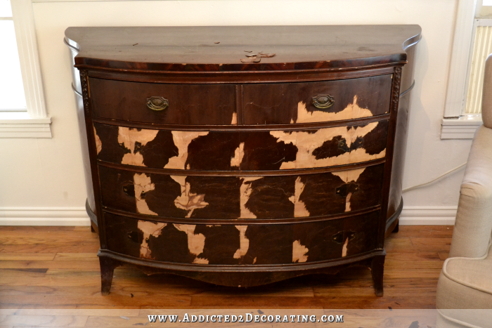 Antique credenza with damaged veneer