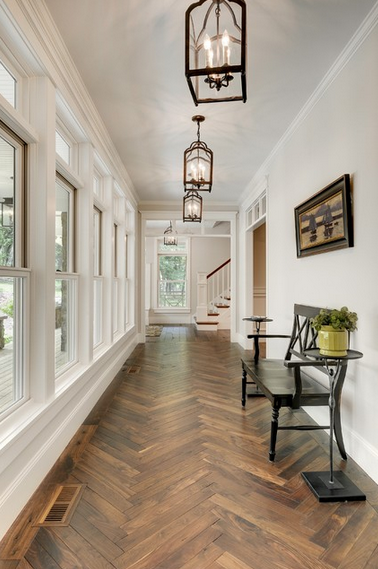 Herringbone wood floor -- Divine Custom Homes foyer via Houzz.com