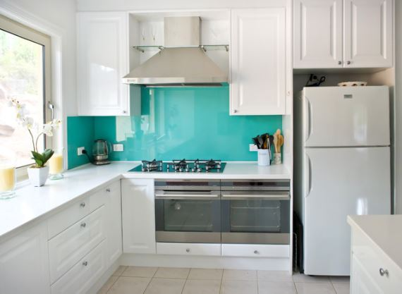 Kitchen with turquoise back painted backsplash, via Houzz.com