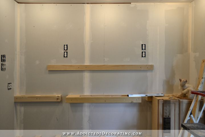 Wall of cabinets installed plus how to install upper for Hanging kitchen cabinets