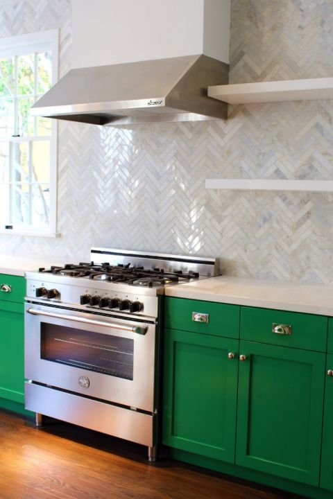 kitchen with green cabinets and herringbone tile backsplash, by Kishani Perera