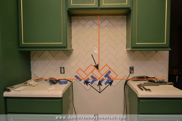 How to install a herringbone subway tile backsplash How to put tile on wall in the kitchen