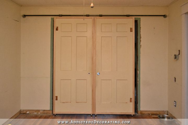 DIY rolling barn door style doors with inexpensive hardware