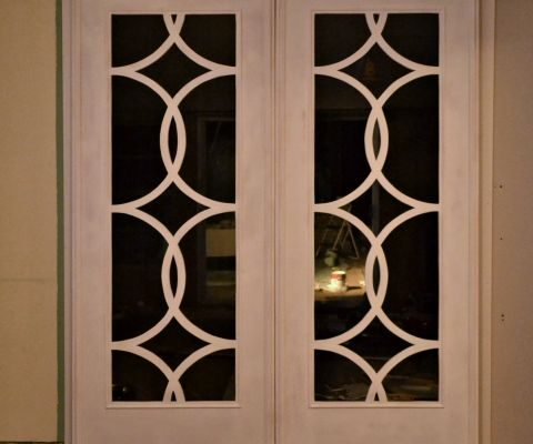 Rolling French doors with circle fretwork inspired by the doors of the Palazzo Hotel in Las Vegas