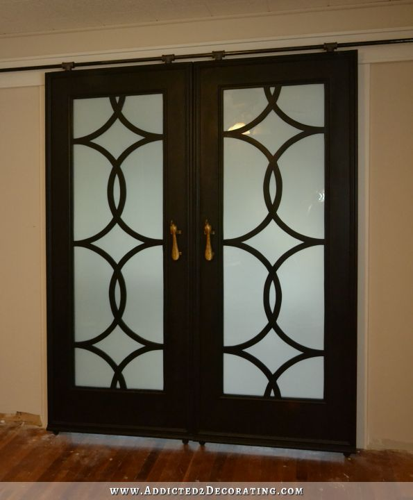 DIY French doors with circle frework panels, installed on DIY barn door hardware