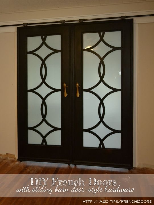 DIY French doors with circle fretwork panels, installed in inexpensive DIY barn door hardware