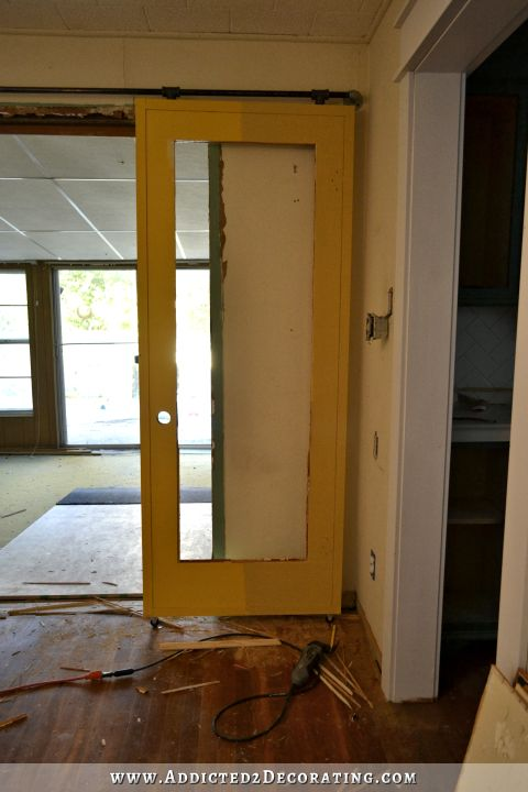 repurposed old door into french door